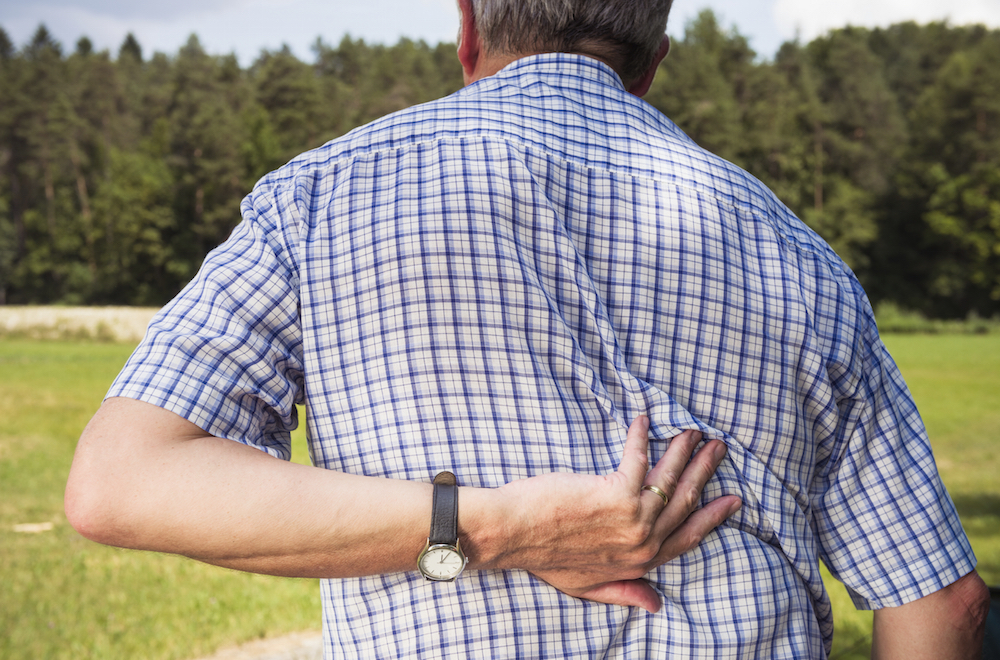 MR MR Rear view of an elderly man reaching for his lower back. [url=file_closeup?id=27022150][img]/file_thumbview/27022150/1[/img][/url]